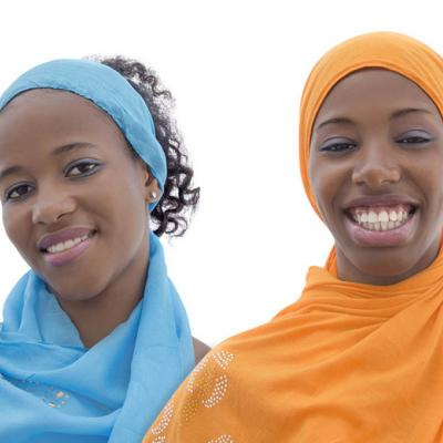 Two young women wearing headscarves