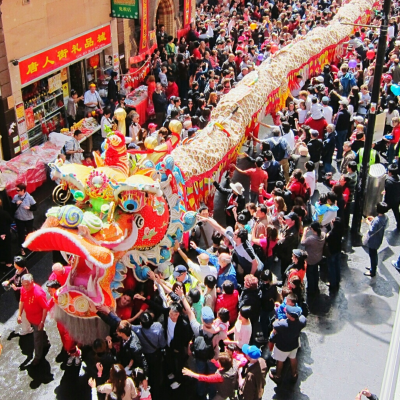 High Angle View Of Dragon Dancer On Street During Chinese New Year - stock photo